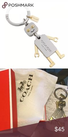 """COACH Silver Robot Keychain Authentic W/ Gift Box COACH KEY CHAIN FOB 100% authentic Purchased directly from COACH Comes with COACH drawstring bag, Gift Box, and Gift Receipt Very cute silver & gold robot with turn lock accents Makes a great gift! We have a clean and smoke free home  Silver and Gold tone  Movable Limbs 2.5"""" length of Robot 1.25"""" length of silver ring 4"""" of total length Coach Accessories Key & Card Holders"""