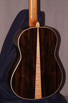 Luthier: Jim HollerThe Wedge #2US Patent Bent Top: #6894209 B2Year: 2009Number: 88Price: Hold Another will be started soonTop: Old Spruce 30 + yearsBack:Malaysian BlackwoodSides: Malaysian BlackwoodBinding: Curly MapleRosette: Birds eye Maple with Madagascar RosewoodBridge: Brazilian Rosewood wit...