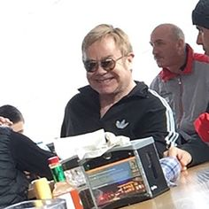 A reddit user has shared his brother's attempt to take a sneaky picture of Sir Elton John in a restaurant.
