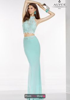 Chic Alyce Paris prom dress 6520 features a halter crop top and fitted jersey skirt. This two piece Alyce Paris dress 6520 is a marvelous choice to wear to a social occasion. The long fitted jersey skirt has a beaded waist line while the all beaded top has a high neckline. Top off this dress with a pair of long earrings and a chunky bracelet.