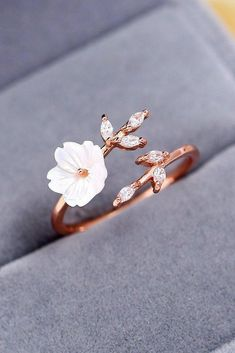 Spring Wedding Sakura Blossom Ring This beautiful ring can help pull your whole wedding aesthetic together. With a flower made from shell, leaves decorated with zircon gems, and a rose gold band made to look like a branch wrapping around your finger, this Cute Rings, Unique Rings, Beautiful Rings, Unique Wedding Rings, Unique Promise Rings, Promise Rings For Her, Unusual Jewelry, Pretty Rings, Most Beautiful Engagement Rings