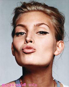 eyeliner. nude lipstick.