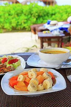 NadyaEugene Photography - fruit salad, soup and chicken rice served on beach restaurant