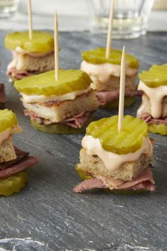 Reuben Pickle Bites This pickle-on-a-stick appetizer has all the flavors of a classic Reuben sandwich in one small bite. Watch this crowd-pleasing no-cook appetizer disappear in a snap at a party, game-watch or tailgate. No Cook Appetizers, Finger Food Appetizers, Appetizers For Party, Appetizer Recipes, Tailgate Appetizers, Healthy Appetizers, Finger Foods For Party, Irish Appetizers, Sandwich Appetizers