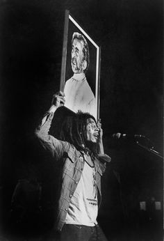 Bob Marley Standing firm under Selassie I banner....