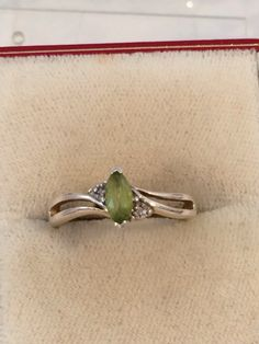 Sterling Silver 925 Peridot Diamond Ring Size 8 by JewelryGeeks on Etsy https://www.etsy.com/listing/217596470/sterling-silver-925-peridot-diamond-ring Sold!!!!!!!!