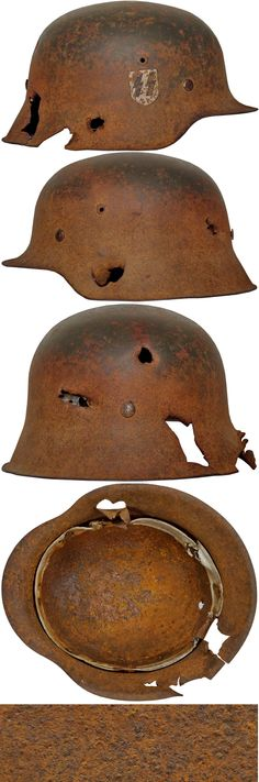 """Very nice M42 """"BATTLE DAMAGED"""" SINGLE DECAL HELMET. (Stahlhelm M40)  Check out my website for more original WW2 items for sale. We also buy your WW2 material   http://www.vantiques.nl"""