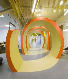 Love this tunnel from Yandex Saint Petersburg Office II by Za Bor Architects - looks like a big bit of orange peel?