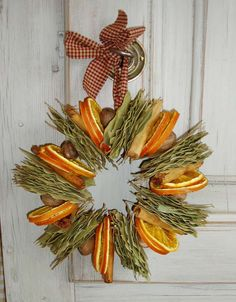 Bay leaves, apple or orange slices, cinnamon sticks and nutmegs wired into a circle with a homespun fabric hanger. Hang on the wall in the kitchen, above a fireplace etc.