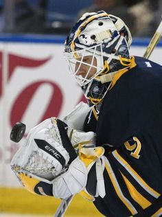 Buffalo Sabres goaltender Chad Johnson makes one of his 44 saves against the Anaheim Ducks during second period action of an NHL hockey game, Thursday Dec. 17, 2015 in Buffalo, N.Y. Buffalo won 3-0. (AP Photo/Gary Wiepert)