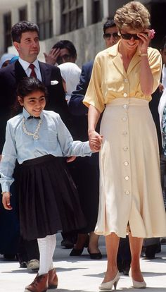 3177e6b8b Princess Diana holiday outfits: in a yellow button through blouse and cream  skirt in Egypt
