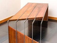 Absolutely stunning Brazilian Cherry (some call it teak) Modern Bench. Rich grain and vivid color set against the cool linear lines of the stainless steel bar. Size: 23x72x20 tall Please visit our other fine pieces at www.visualmetals.com SHIPPING: In order to offer our customers the most accurate shipping cost, shipping is not included with this purchase. Please email us for a quote - brent@visualmetals.com