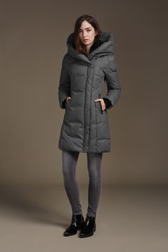 CAMYL-F6 is a slim fit, body framing coat with oversize folded hood and asymmetrical collar. The signature brushed down shell is water resistant for all weather wear. Down filled throughout, this style is a smart balance of feminine and minimalist elements. Side panels and leather welt pockets provide slimming effects while ribbed insert cuffs add extra warmth. Discover at http://www.soiakyo.com/ca/en/camyl-f6-hooded-down-coat-with-oversized-collar-in-ash-for-women