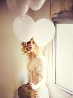 Behind the white balloons