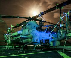 Marines from 15th MEU perform post-flight maintenance on an AH-1Z Viper aboard the USS Anchorage