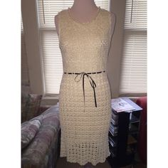 Diane von Furstenberg Ivory Crochet Dress Diane von Furstenberg, Ivory Crochet Dress.  Purchased from upscale boutique, dress is in Beautiful condition. Has keyhole back and buttons at the top. Has ribbon that tightens dress as you tie it, Fits to body, but stretches.. I'm not exactly sure of the size but based on measurements it can fit a Small/ Medium. Length (from top of shoulders to hem): 40.5 inches, Waist (at ribbon): 14.5 in., Bust: 15.5 in., Lining Length: 32 in. Measurements taken…