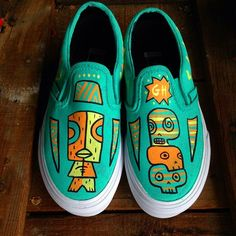 Tiki Vans for a little dude of 5. Somehow, they don't look small in the photo. This kid picked his own color palette and I'm digging it! #tiki #tikiart #tikivans #vans #customshoes #customvans #handpaintedshoes #paintedvans #skull #pop #surf #surfart #bea