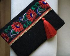 Bohemian clutch, Ethnic Clutch, Womens Bag, Mothers day Gift, Evening Bag, Grey Clutch, Boho Style, Indian Style, Floral Bag, Clutch Purse A fashion statement that everyone will swoon over! This floral clutch will bring elegance to your style. It will be chic with jeans or dresses and you may use this clutch bag both day and night. This clutch bag is perfectly handmade with high quality natural jute fabric. Designed with a silk bohemian embroidery and a tassel. Clutch has a pink silk satin…