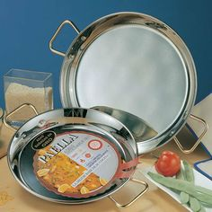 "Electric Stove-top Stainless Steel Paella Pan - 13 inch - 32 cm by Garcima. $65.00. Crafted with care in Spain. Dishwasher safe. Size: Approximately 5 servings. Stainless steel construction with superb craftsmanship.. Stainless steel for zero-maintenance and easy cleaning. ""La Ideal"" Paella de Acero Inoxidable, 18/8 stainless steel. ---Dishwasher Safe---"