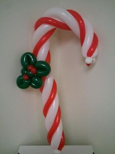 1000 images about globos y maquillaje navidad on for Candy cane balloon sculpture