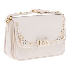Miu Miu's Madras Borchie Shoulder Bag made of goat leather adorned with swarovski crystals and gold and palladium studs.  $1,150.  The shoulder strap can also double as a belt which I love.  Love the bow of course and I adore the decorations.  There is a plain flap on the other side.