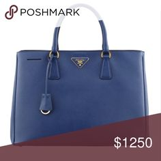 "Prada Gardener's Tote Bag, Blue (Bluette) Amazing condition. Worn once or twice. A classic Prada design. 100% authentic.                    Saffiano calfskin. Golden hardware. Double handles; 5"" drop. Hanging key ring. Open top; snap sides. Authenticity card included. Offers accepted! Prada Bags Totes"