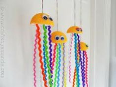 JELLY-FISH MADE OUT OF HALF A STYROFOAM BALL, GOOGLE EYES AND PIPE-CLEANERS.  I DON'T KNOW WHAT HOLIDAY THEY WOULD BE GOOD FOR (NATIONAL SEA CREATURE DAY?), BUT THEY SURE ARE COOL!