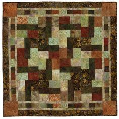 If combining colors is a challenge for you, turn to Mother Nature for inspiration. Batik fabrics in a variety of autumn colors, patterns, and textures are assembled into a square table topper.