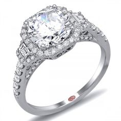 Demarco 18K White Gold Halo Engagement Ring With 0.14 Carat Baguette Diamonds and 0.46 Carat Round Diamonds