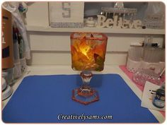 Next time you're at the Dollar Store, grab a glass vase and copy this woman's gorgeous idea!