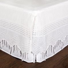 Vintage-inspired, this Bed Skirt features a soft cotton crochet and hanging fringes.  linen Cotton crochet trim