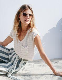 round sunglasses, striped crop top & stripes paper bag pants #style #fashion #stripes