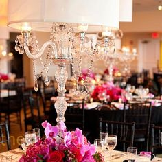 Some of the centerpieces will be tall crystal candelabras with lampshades covered in handmade gold and white paper.