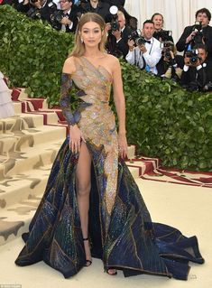 Effortlessly glamorous: Gigi Hadid chose a colorful dress by Versace featuring a stained glass dress design