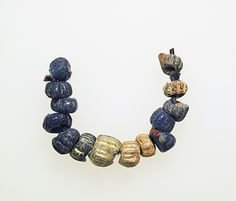 Roman blue glass beads with inclusions http://www.metmuseum.org/Collections/search-the-collections/249754?rpp=20&pg=147&ft=*&what=Beads&pos=2932