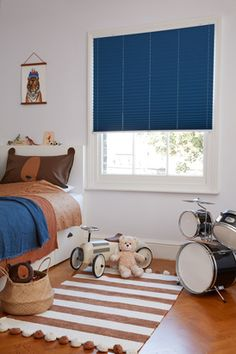 The dark crisp blue of this Lanbury blind contrasts well with the bright white décor, helping to give this kids' bedroom a clean, streamlined look. Blue Bedroom, Kids Bedroom, Bedroom Ideas, Childrens Blinds, Nursery Blinds, Blackout Blinds, Blue Throws, White Decor, Beautiful Homes