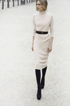 simple. classic. White turtleneck dress with a black belt at the waist, black tights and ankle boots, winter outfit ideas, timeless, elegant