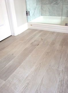 bathrooms - Italian Porcelain Plank Tile, faux wood tile, tile that looks like- wood, Italian Porcelain Plank Tile Bathroom Floor by I would chose a different wood tone, but I do like that wood look tile on the floor! Faux Wood Tiles, Wood Tile Floors, Wood Look Tile Floor, Wood Plank Tile, Ceramic Wood Tile Floor, Faux Wood Flooring, Wood Grain Tile, Tile Looks Like Hardwood, Basement Flooring