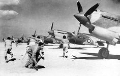 Men of a British RAF fighter squadron are seen at an unknown airfield in Libya as they rush to their Tomahawks, on February during the Axis occupation of North Africa Afrika Corps, North African Campaign, Royal Australian Air Force, Ww2 Aircraft, Military Aircraft, Ww2 Planes, Vintage Airplanes, Royal Air Force, Military History