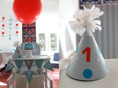 Modern Elephant Balloon Birthday: Can a first birthday party be modern, fun, and sophisticated all at once? Oh yeah! All the party details were handmade — from the garlands to the party hats — and the birthday boy had his own little mini cake.  Source: Dulce Sobre Mesa
