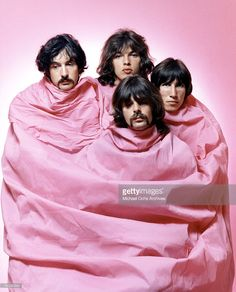 Psychedelic rock group Pink Floyd pose for a portrait shrouded in pink in August of 1968 in Los Angeles. (L-R) Nick Mason, Dave Gilmour, Rick Wright (center front), Roger Waters.