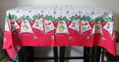 Bells and Carolers Christmas Mid Century Vintage Christmas Rectangular Retro Kitsch Repaired Tablecloth 64 x 69- Great for Crafts, $15.00