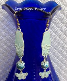 July Challenge .. Butterfly Earrings .. Almost everything is from B'sue .. I painted the components white then a small amount of perfect pearls was used .. look at those beautiful Spectra Beads .. Jann Tague .. Clever Designs .. https://www.facebook.com/JewelsByJann