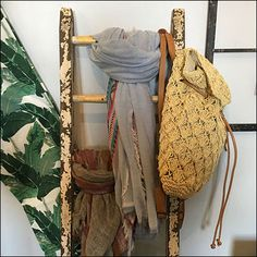 "Including a single macrame bag, this Leaning Ladder Scarf Merchandising is the ""height"" of informality (ladder pun intended). Leaning Ladder, Big Peach, Scarf Knots, Macrame Bag, Reusable Tote Bags, Retail, Shops, Retail Merchandising, Scarf Tieing"