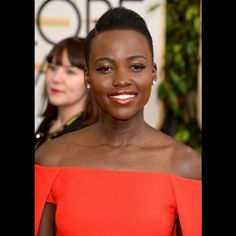Get Lupita Nyong'o's Golden Globes Look!  Here's how to get her hairstyle with KBB: Part hair with an extreme side part. Pull hair back on each side, lifting at crown, then apply Hold It Hair Gel w/Argan Oil for light, flexible hold and moisture. Smooth any difficult edges or pieces to keep hair in place with Sleek Strands Edge Control. Finally, lightly mist hair with Hair Blossom Moisture Mist to add shine and hydration. Now you're red carpet ready for your close-up!