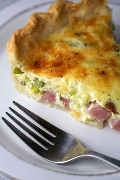 Savory Ham and Asparagus Quiche - This is the perfect recipe to make for brunch. The buttery crust is filled with egg custard, ham, leeks, chives, and asparagus. | jessicagavin.com