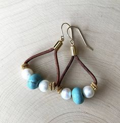 Make your style voice heard without saying a word each time you wear these fabulous leather teardrop earrings! Simple, casual and current, this southwestern jewelry is great with your jeans and boots. If you love turquoise and boho jewelry - or know someone who does - look no