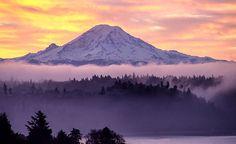 Fog layer sits under Mt. Rainier as the sun rises. (Photo: Jonathan Cooper)