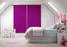 Sliding wardrobes in white and pink glass. Our extensive collection of bespoke sliding wardrobes is available in over 20 colours. #pinkbedroom #girlsbedroom #slidingwardrobes #fittedwardrobes #tidyroom #bedroomfurniture