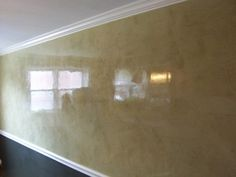 How to smooth plaster walls with luxurious cream color.